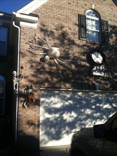 Cheesecloth mached over chicken wire spider. Halloween exterminator skeleton.