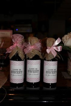 "This Mommy Loves: Rustic Bridal Shower.  Favors:  Sangria bottles (matched the Signature Cocktail) with custom labels which read ""Love is Sweet, See you in December"""
