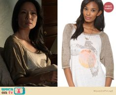 Joan's baseball tee with orange bird graphic in bed on Elementary. Outfit Details: http://wornontv.net/22111 #Elementary