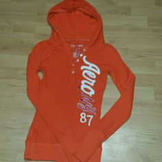 Cute hooded top Beautiful bright orange top by aeropostale never worn but no tags Aeropostale Tops Tees - Long Sleeve