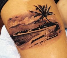 A small and cute looking beach tattoo. The design shows a small car parked in a silent beach bordered by silent waves and palm trees.