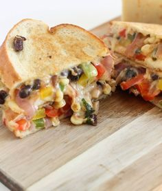 A super flavorful pepper jack grilled cheese with a vegetarian fajita filling with peppers, onions, corn and black beans.