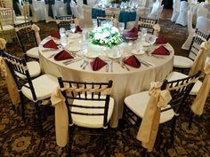 Beige majestic tablecloth with  burgundy napkins and GORGEOUS chair weaving #beautiful #chivari #love #xo #wedding #thegirls #events #perfect #decor