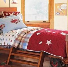 Tanner's Pottery Barn Kids bedding (his bumper is red w/ stars, sheets have the little trucks on them and skirt is white w/ the same trucks embroidered along the bottom. His glider and curtains are the Thomas plaid.) The truck bedding has been discontinued by PBK :(