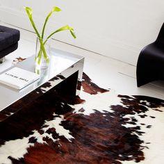 cow skin rugs...love!!