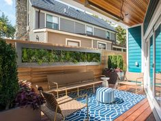 Small Deck With Custom Vertical Garden, Wood Privacy Wall and Bright Blue Accents