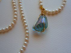 Freshwater Pearls long necklace with gold filled wire wrapped Aqua Aura Crystal Quartz pendant. Gemstone Necklace, Turquoise Necklace, Pendant Necklace, Promotion Party, Freshwater Pearl Necklaces, Crystals And Gemstones, Handmade Art, Quartz Crystal, Jewelery