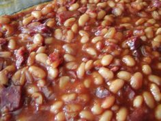 Hawaiian Baked Beans Recipe - Genius Kitchen Great for luaus, family gatherings, barbecues and other occasions where you have a few mouths to feed. Hawaiian Baked Beans, Hawaiian Dishes, Hawaiian Recipes, Hawaiian Luau Party, Food For Luau Party, Hawiian Party Food, Aloha Party, Hawaiian Food Parties, Hawaiian Theme Food