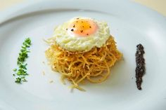 """""""tsouchtes"""" traditional greek recipe by MANHMANH restaurant...handmade spaghetti covered with a fried egg"""