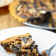 Chocolate Bourbon Pecan Pie Recipe Desserts with semi-sweet chocolate morsels, pecans, corn syrup, brown sugar, large eggs, vanilla extract, salt, bourbon whiskey, unsalted butter, pie crust
