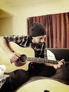 Avi with a guitar...I want to meet him and just have a jam session.
