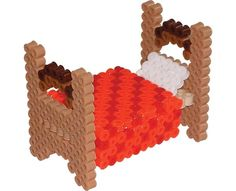 Create your own dollhouse furniture with this cute 3-D bed made of Perler Beads. You will even have a pillow and a cozy quilt! Simple tab/slot assembly.