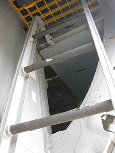 KC-135 ladder by Little Chubby Panda, via Flickr  One handed climb carrying all our gear, the yellow grate was real heavy and if you didn't latch it good you could get knocked out if it fell on your head.