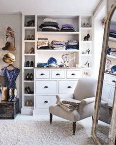Yes, you an decorate a closet to be as pretty as it is functional.  Love the upholstered chair, the mirror and the throw carpet.  Cozy.