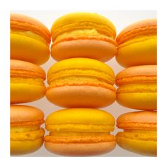 Mango Macarons by Swallow My Words. Custom Macarons available online: www.SwallowMyWords.com  Nationwide shipping available