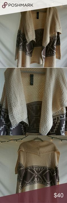 Super cozy cream cardigan Nwt cream cardigan. Cozy+ casual= perfection. Cardigan in brand new condition. cozy Sweaters Cardigans