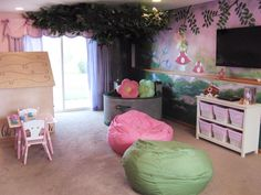 Decorating Ideas for Fun Playrooms and Kids' Bedrooms : An oak tree sprouts out of the corner taking the wall mural from 2-D to 3-D. Beanbags, cushions and plush carpet give this magic forest setting a soft terrain. Design by Sherri Blum From DIYnetwork.com
