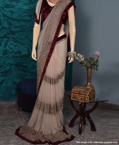 * Saree Fabric : Georgette * Saree Color : Beige * Saree Length : M * Saree Work : Fancy Patta * Blouse Fabric : Velvet * Blouse Color : Maroon * Blouse Length : 1 M * Look : Designer Saree * Wash Care: Dry Clean * Delivery Time: S Bollywood Fashion, Bollywood Saree, Indian Dresses, Indian Outfits, Georgette Fabric, Party Kleidung, Stylish Sarees, Saree Look, Outfits