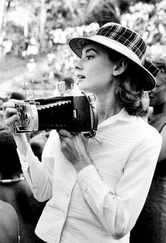 Audrey Hepburn behind the lens (photographed by Leo Fuchs, 1958).