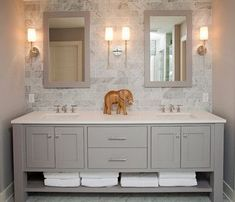 Hall Bath // Double sink vanity with drawers and shelf at bottom.