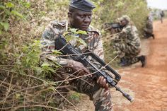 A Cameroon soldier provides security during a patrol on exercise in 2014