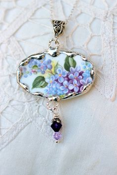 Broken China Jewelry, Oval Pendant Necklace, Royal Albert, Purple Lilacs, Sterling Silver Chain. $44.95, via Etsy.