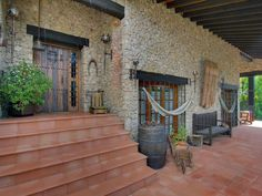 Brick wall in exterior area of magnificent rustic designed stone country house in Torrelodones, Madrid. #outdoorliving #rusticchic #rustic