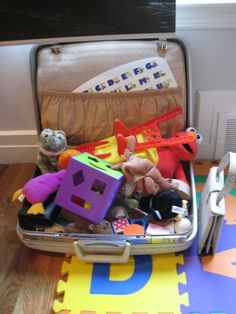 An old suitcase! Slide it out of the way under the bed when closed.