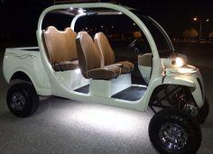 Llifted pearl white GEM car with custom molden bed, faux alligator brown seats. #customgemcar #innovationmotorsports #gemcarforsale #gemcarupgrades