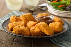 Who doesn't love chicken nuggets?  Cheesy SHAKE 'N BAKE, a hint of mustard and a creamy barbecue dipping sauce make these extra special.