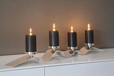 Moderner Kerzenleuchter WAVE von FINK beinhaltet 4 Kerzenhalter und ist vernickelt. http://www.deSaive-deSign.de/Leuchter-WAVE