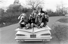 On a '59 Chevrolet Impala convertible, journalists and photographers lead Senator Kennedy's presidential campaign caravan in Illinois, 1959. Photo by Paul Schutzer, LIFE.