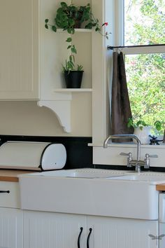 Diy cabinet details. I love the idea if adding plant shelves next to the sink window. A++ use of space.