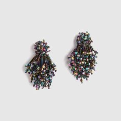 """Hand beaded earrings with glass beading on leather backing. Polished rhodium post back Length: 2"""" top to bottom Width: 1"""" at widest Weight: 0.3 oz"""