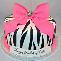 birthday cake covered in zebra patterned fondant