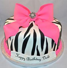 birthday cake covered in zebra patterned fondant