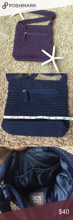 "SAK Navy Crossbody Purse SAK Navy Crocheted Crossbody Purse. Like New Condition. Very clean bottom as pictured with the measuring tape. Two inner pouch pockets and one zip pocket. Handle is 45"" total. The Sak Bags Crossbody Bags"