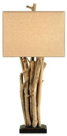 """A very earthy table lamp featuring driftwood and a beige linen shade. The lamp is made with wrought iron with a natural wood finish. Features a 3-way bulb function and takes a 150 watt max """"A"""" bulb (n                                                                                                                                                                                 More"""