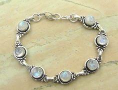 11.20ctw Genuine Rainbow Moonstone & .925 Sterling Silver Plated Brass Bracelet (SJHB0009RMS) #silverbracelets #braceletsilver #braceletdesigns #sterlingsilverbracelets #silverbraceletsforwomen #braceletsformen #sterlingsilvercharmbracelet #bracelet #personalizedbracelets #gemstonebracelets #handmadebracelets #silvercharmbracelet Buy Now: http://www.sterlingsilverjewelry.tv/genuine-rainbow-moonstone-silver-plated-brass-link-bracelet-sjhb0009rms.html