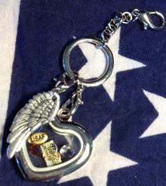 USAF Themed floating locket.  Has a support our troops charm, USAF charm, 1 red crystal and 1 clear crystal.   found at www.charmingincentives.com     #floating #charm #locket