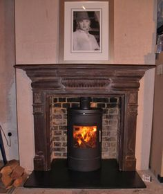 Original Victorian cast iron surround with slate hearth, renovated brick chamber and Morso 6140 wood stove, fitted in Queens Park, London NW 6 by Scarlett @ Design a fireplace 2009