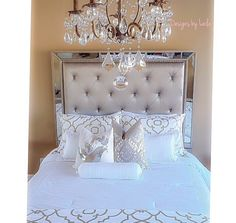 Gorgeous chandelier and bed. ❤️