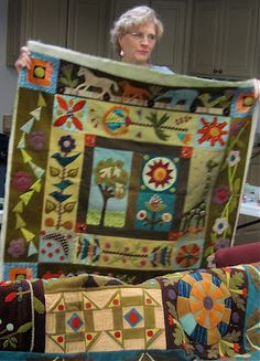 I have done this Sue Spargo quilt, colours different and added an ark