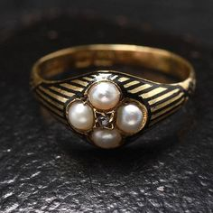 Victorian Diamond and Pearl Mourning Ring with Striped Enamel, c. 1883, $1,400