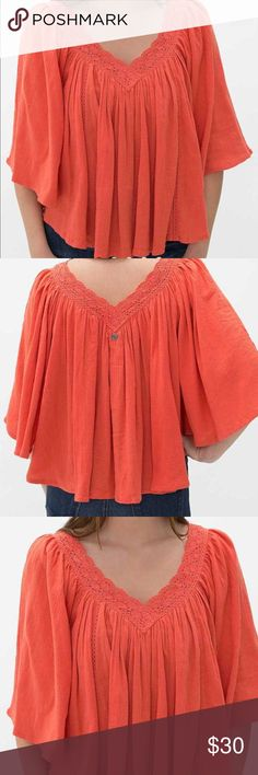 Billabong hidden blossom top Super cute size small in hot coral. New with tags $54.95 Billabong Tops Blouses