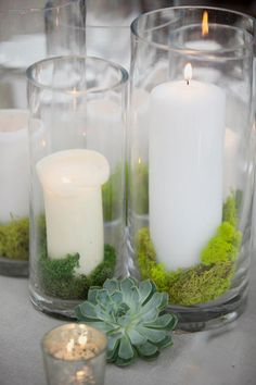 Simple can be beautiful too. Succulents, silver mercury glass votive, a clear glass cylinder vase with a pillar candle and moss. Find all these products at Afloral.com and more ideas like these at thevinesleaf.com