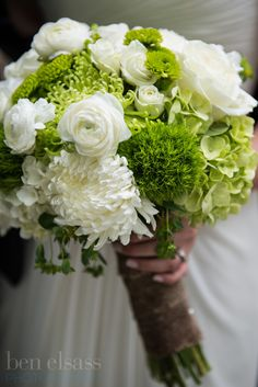 #Bridalbouquet with green trick dianthus, white football mums, spray roses, green and white hydrangeas, ranunculus, bupleurum, and green button mums. photo by http://www.benelsassphotography.com/
