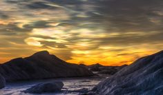 The rich colors created by ice nacreous clouds. All photos by Anthony Powell. Antarctica: A Year On Ice Time Lapse Film, Places Around The World, Around The Worlds, High Clouds, Antarctica, Continents, Beautiful World, The Great Outdoors, Places To See