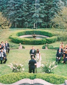 An Intimate Garden Wedding at a Michigan Bed & Breakfast   Martha Stewart Weddings - The ceremony took place overlooking a lake at Greencrest Manor. Overgrown ivy, fountains, and gardens created a picturesque backdrop for the garden wedding. #summerwedding #weddingideas #weddingceremony #wedding