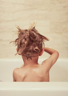 """Bath Time"".  I absolutely love this photo with his tussled, soapy hair.   Almost every kid at some point has sat in the bath with soapy hair, completely engrossed in imaginative water-play.  To me, this photo captures the innocence of childhood.   ~Skye"